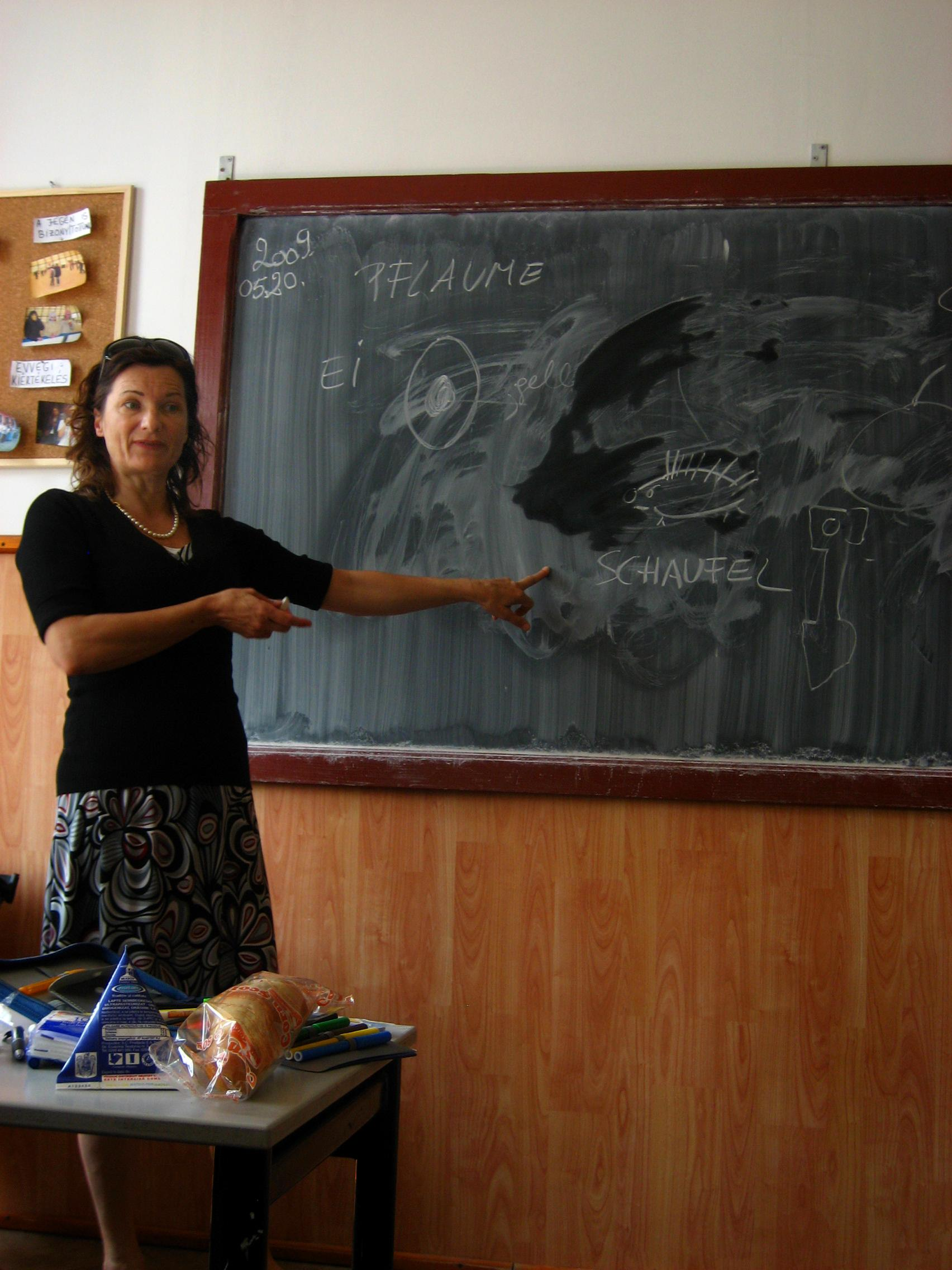 Projects Abroad volunteer runs an English language class as part of her teaching work experience in Romania